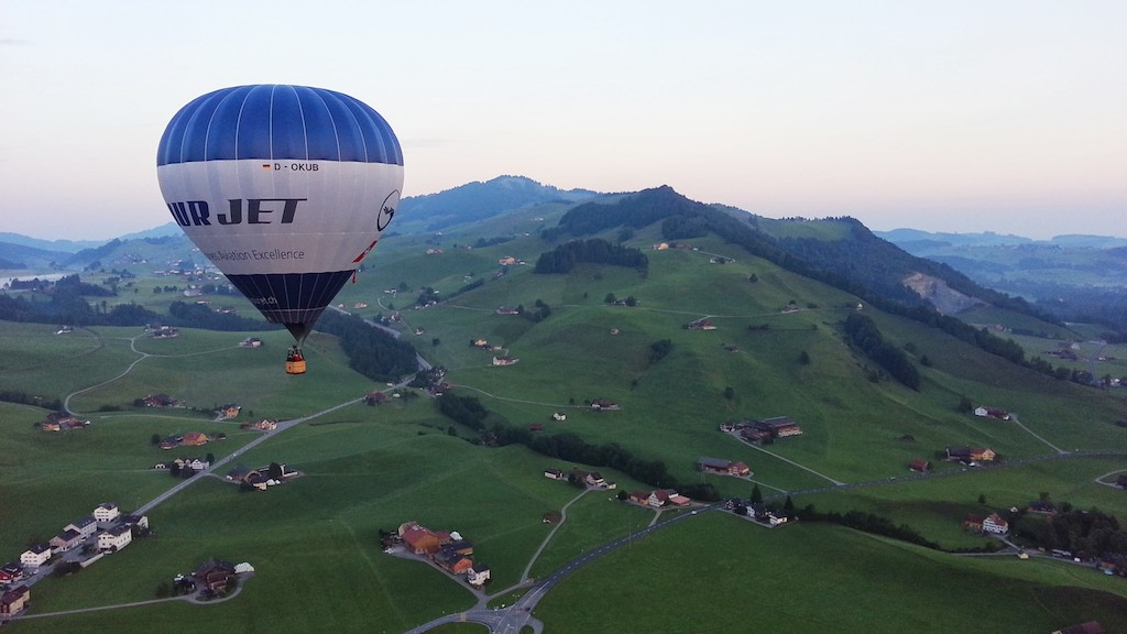 Floating over Appenzell as the morning sun gilds the land