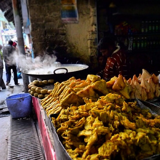 Everyone's invited! On a cold evening in the mountains, nothing tempts like these fried snacks. In Ghanghariya, Uttarakhand. #travel #himalaya #food #india